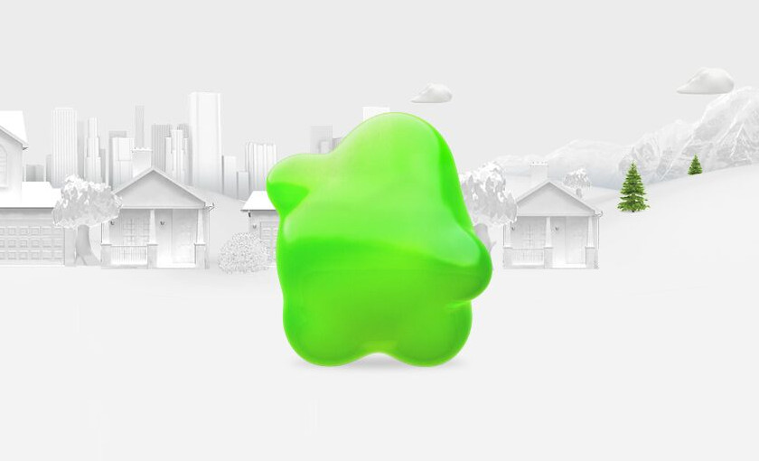 Greenlight mascot against a row of homes